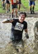 Richard Boston running through mud